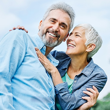 Older Couple Smiling Outdoors Image